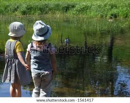 Children feeding seagull - stock photo