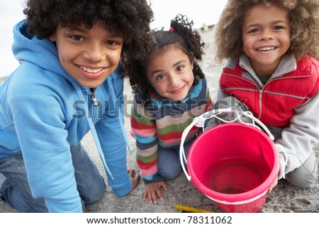 Children fishing for crabs - stock photo
