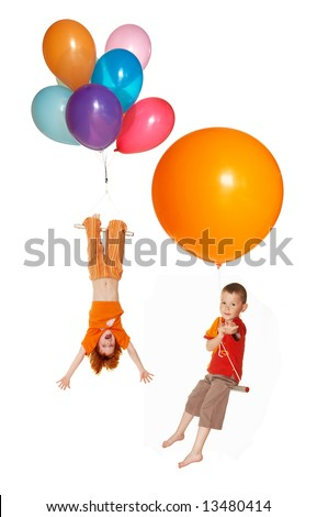 Children fly by balloons - stock photo