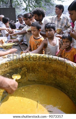 Children getting free food in the streets of Delhi, India - stock photo