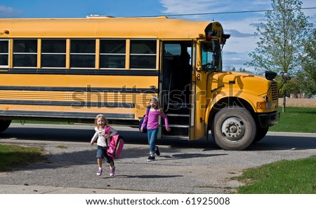 children getting off school bus