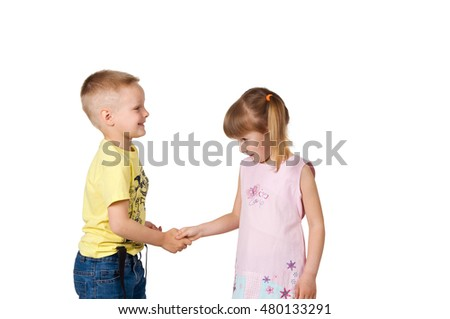 children. girl and boy shaking hands with each other