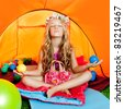 Children girl in camping tent practicing yoga open arms and balls - stock photo