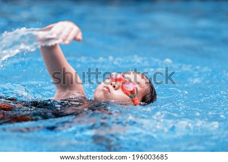 children girl in swimming pool - stock photo