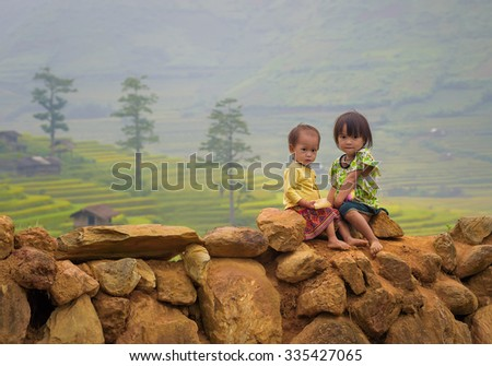 Children girl smile of rice terraces background ,Tu Lu Yen Bai, Vietnam.