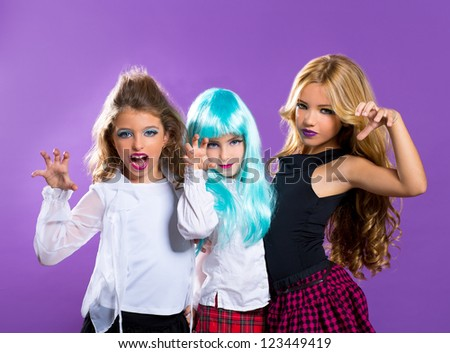 children group of fashiondoll friends scaring gesture girls on purple - stock photo