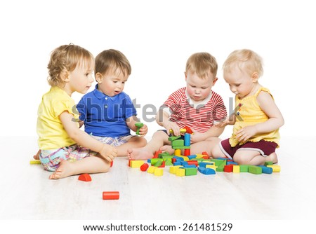Children Group Playing Toy Blocks. Little Kids Early Development. Baby Activity One Year Old Games, Isolated Over White Background - stock photo