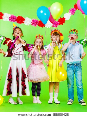 Children group with birthday blow outs - stock photo