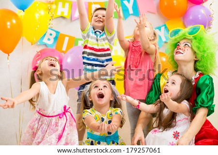 children group with clown celebrating  birthday party - stock photo
