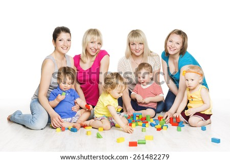 Children Group with Mothers Playing Toy Blocks. Little Kids Early Development. Baby Active Games, Isolated Over White Background - stock photo