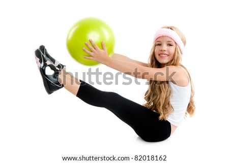Children gym girl with green yoga ball on pilate exercise - stock photo