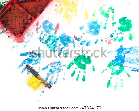 Children hand prints with toys on hand painting playground. On white - stock photo