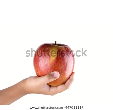 Children hand with an apple isolated on white background.  giving red apple isolated.