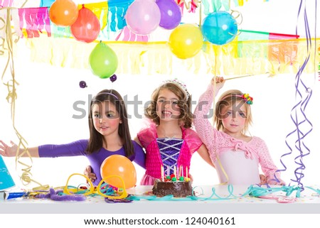 children happy birthday party girls group with balloons and chocolate cake