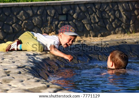 Children have a good time in a swimming pool - stock photo