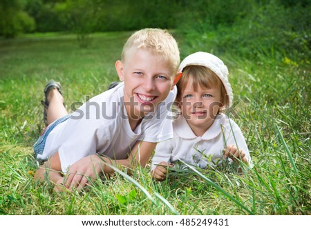 Children have a rest on the nature