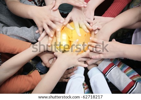 Children have combined hands together to miniature house collage - stock photo