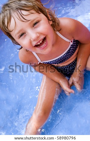 Children have fun playing with water