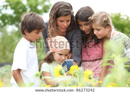 children having a nature class in the park