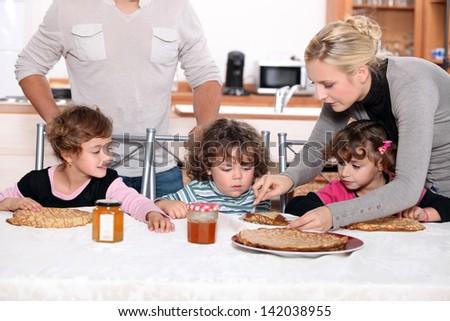 Children having a snack - stock photo