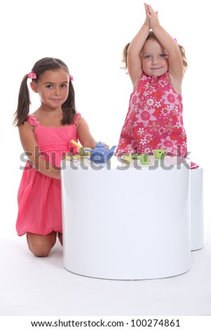 Children having a tea party - stock photo