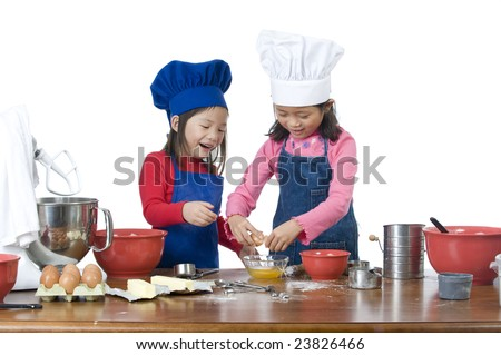 Children having fun cooking by themselves for the first time.