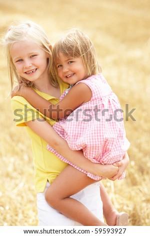 Children Having Fun In Summer Harvested Field - stock photo