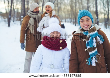 Children having fun outdoors with their parents - stock photo