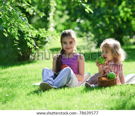 Children having picnic in summer park