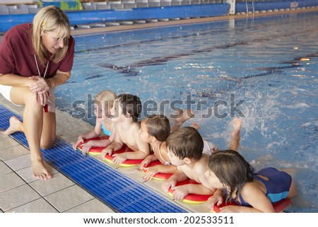 Children having swimming lesson - stock photo