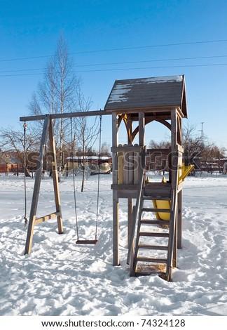Children hillock in winter period on open area - stock photo