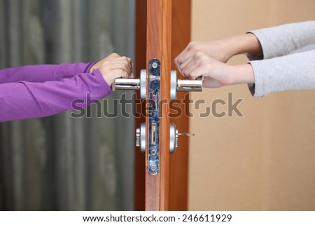 children hold hands on the door handle & Holding The Handle Stock Images Royalty-Free Images u0026 Vectors ... pezcame.com