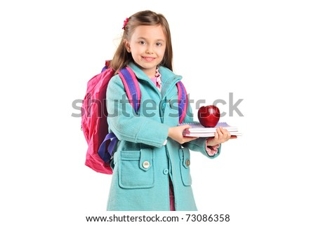 Children holding books and apple isolated on white background