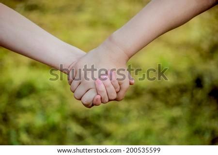 children holding hands - stock photo