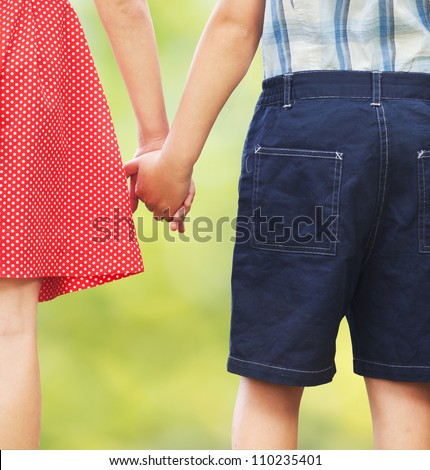 Children holding hands, first love or siblings concept - stock photo