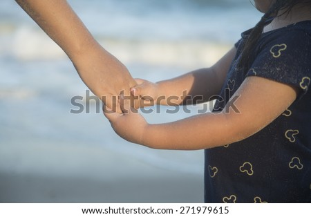 Children holding hands Mother - stock photo