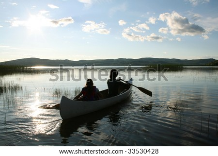 Children in a canoe - stock photo