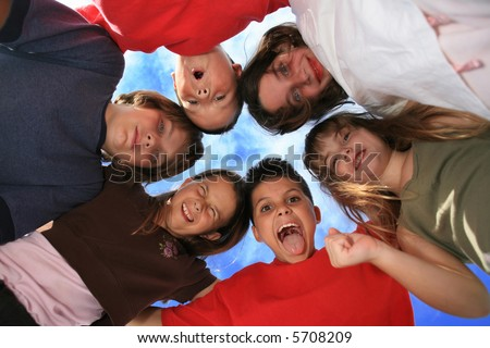 Children in a Circle Against a Beautiful Blue Sky - stock photo