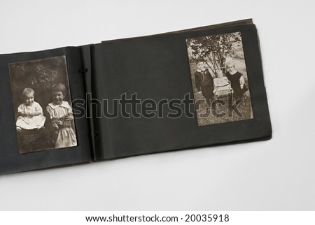 Children in Antique Photo Album - stock photo