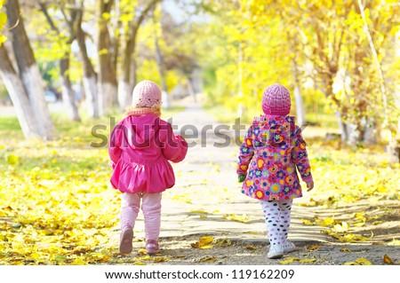 Children in autumnal park - stock photo