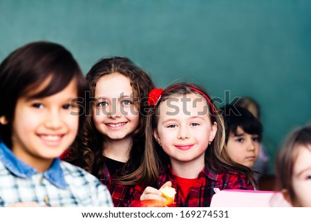 Children in classroom - stock photo
