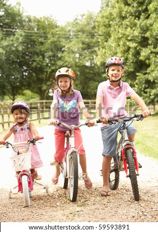 Children In Countryside Wearing Safety Helmets - stock photo
