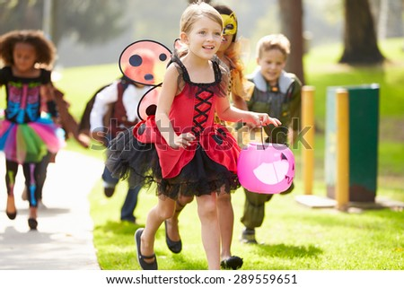Children In Fancy Costume Dress Going Trick Or Treating - stock photo