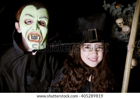 Children in scary Hallowe'en costumes - stock photo