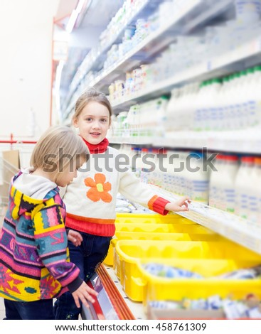children in   store at   shelves with products.