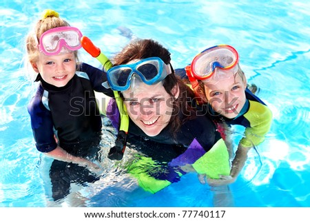Children in swimming pool learning snorkeling. Sport. - stock photo