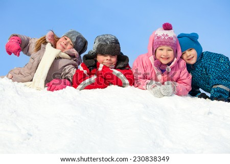 Children in winter. Happy kids on snow - stock photo
