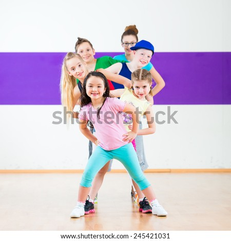 Children in zumba class dancing modern group choreography  - stock photo