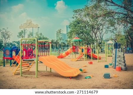 Children kid playground for leisure and recreation activity with toy and slider leftover in the park in childhood color style  - stock photo
