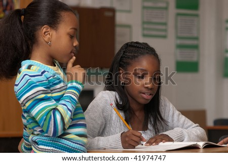 Children learning how to do a lesson together - stock photo